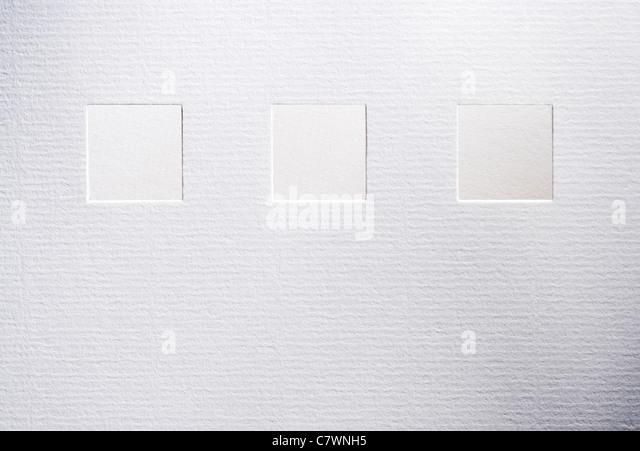 Quadrate schneiden in strukturierten Weißbuch Stockbild