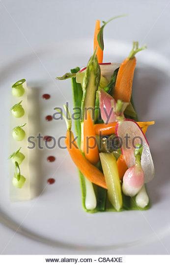 Rohes und gekochtes Gemüse Stockbild