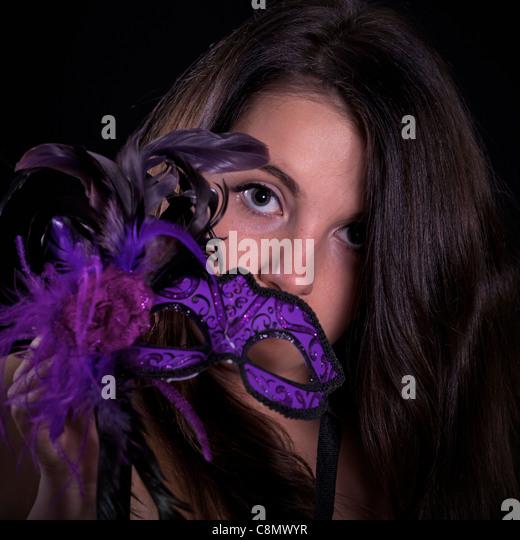 Mädchen mit venezianischer Maske Stockbild