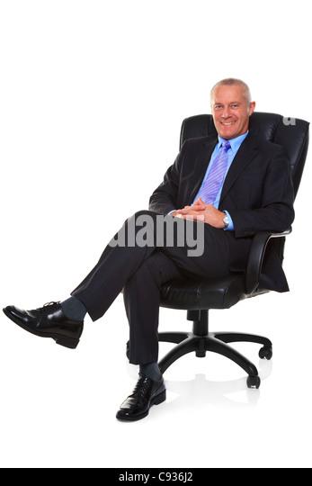 Foto eines ausgereiften Geschäftsmannes tragen eine intelligente Anzug und Krawatte, saß in einem Leder Stockbild