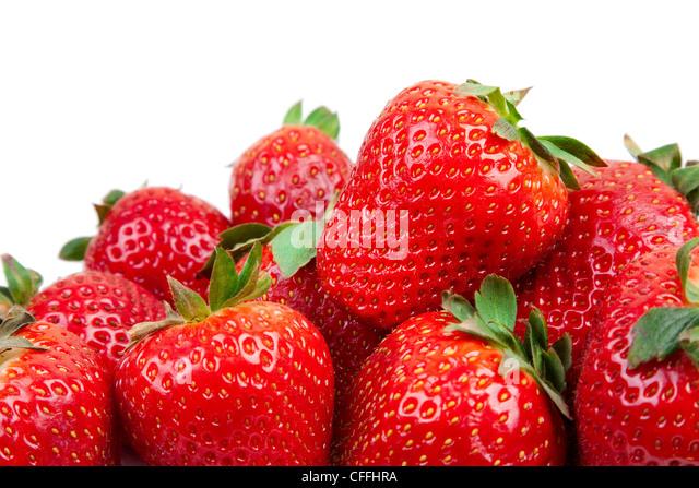 Schließen Sie einige Erdbeeren auf weißem Hintergrund. Stockbild