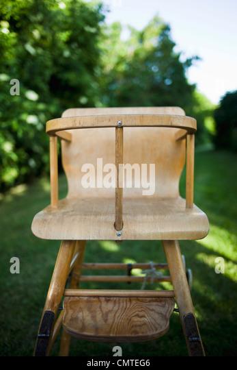 Nahaufnahme von einem altmodischen Kinderstuhl Stockbild