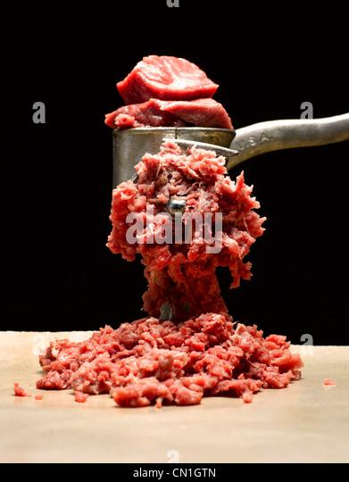 Fleisch und Fleischwolf Stockbild