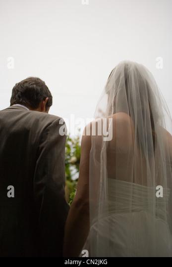 Braut und Bräutigam, Rückansicht Stockbild