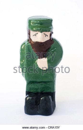 Eine bemaltem Ton-Figur von Fidel Castro auf weißem Hintergrund Stockbild