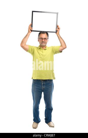 Im mittleren Alter Mann, der einen leeren Bilderrahmen Stockbild