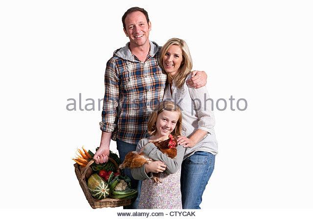 Schneiden Sie aus der Familie mit Bio-Produkten und Huhn Stockbild