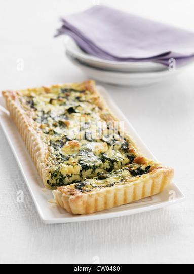 Teller mit Spinat-Tarte Stockbild