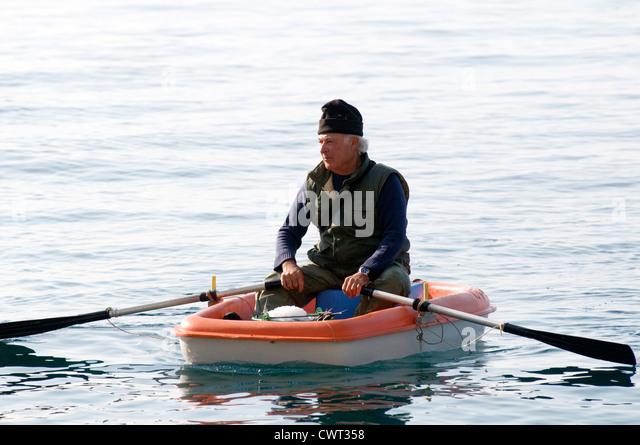 Rowing boat oars old stockfotos rowing boat oars old for Rente grundsicherung hohe