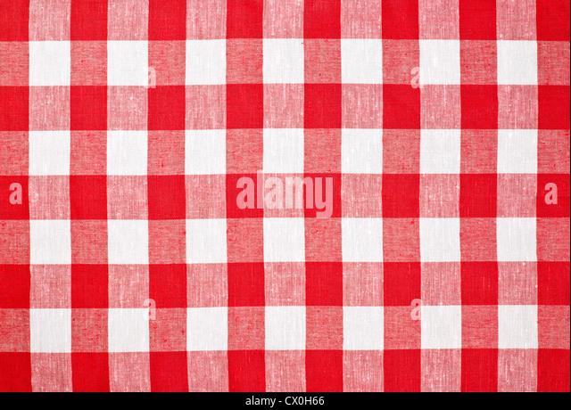 rotem aufgegebenen Stoff Tischdecke Stockbild