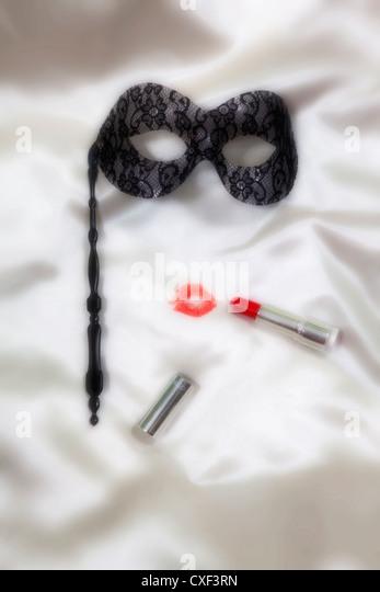 küssen Lippen mit einer venezianischen Maske Stockbild