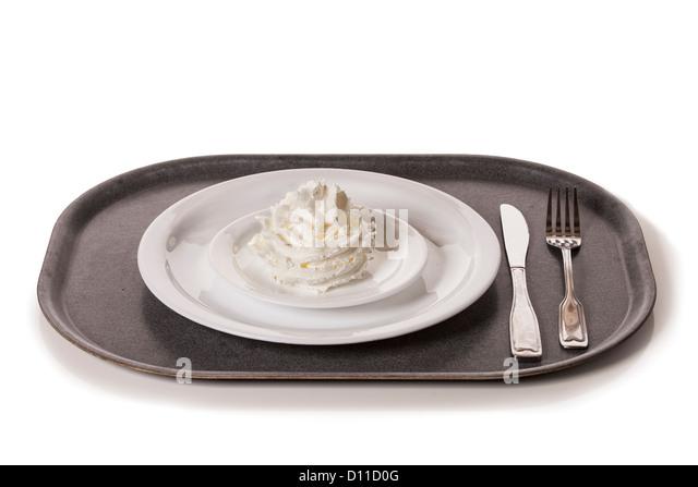 Schlagsahne auf einem Teller, bereit zu einem ungesunden Essen. Stockbild