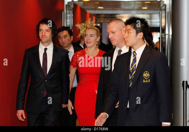 09.12.2012 - Hongkong; Kate Winslet (britische Schauspielerin) und Freund Ned Rocknroll kommt bei den Rennen. Bildnachweis: Stockbild