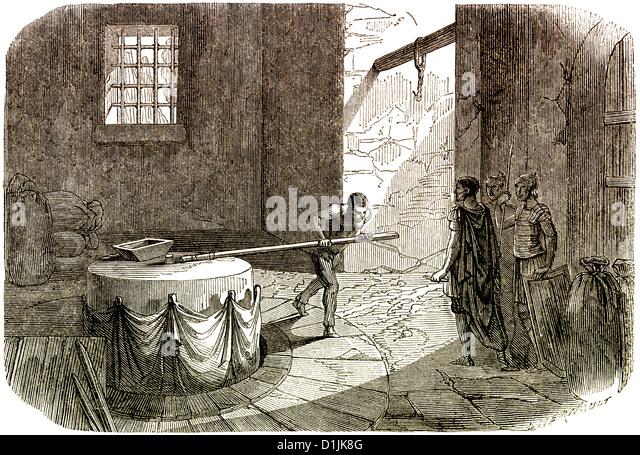 Szene aus der Geschichte von Frankreich, ein Mann drehen einen Mühlstein aus der Gallo-römischen Zivilisation Stockbild