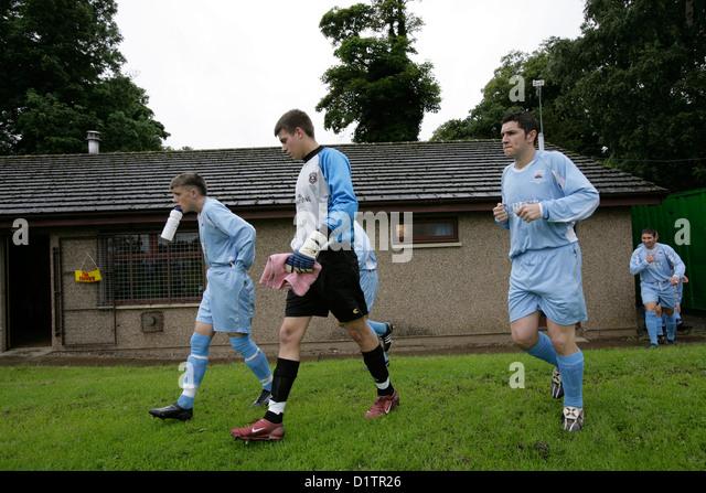 Gretna FC 2008-Fußball-Spieler nehmen zum Feld Kelso zu spielen. Stockbild