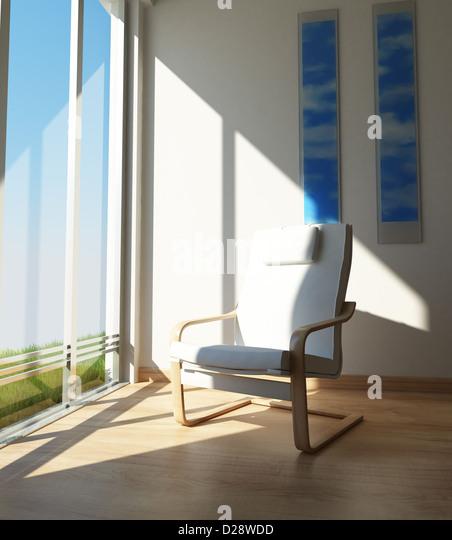 Innenräume. Zeitgenössische Stuhl auf einer Raumecke, neben einem großen Fenster in der Sonne. Stockbild