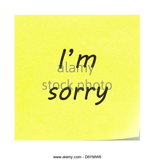 Tut mir leid, auf einem gelben Zettel geschrieben. Post-it Note mit der Ecke schälen sich. Stockbild