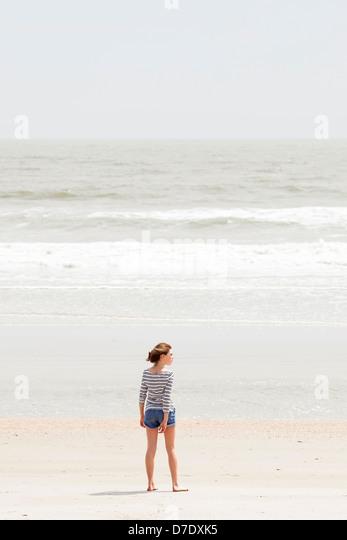 Mädchen am Strand Stockbild