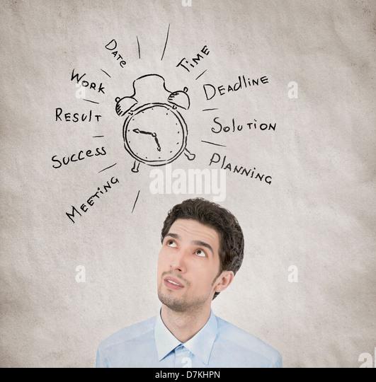Konzept-Porträt der Geschäftsmann seinen Arbeitstag planen möchte in persönliches Wachstum auf Stockbild