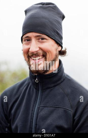 Porträt des Lächelns Mitte erwachsenen Mannes Stockbild