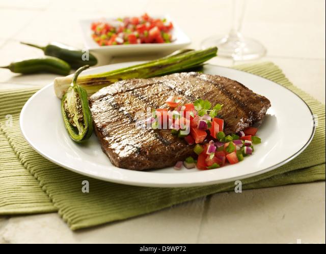 Flanke Steak in Szene Stockbild