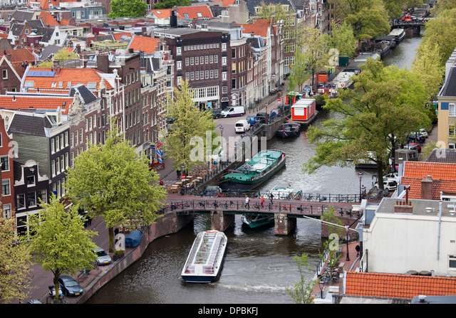 traditional bridge over canal amsterdam stockfotos traditional bridge over canal amsterdam. Black Bedroom Furniture Sets. Home Design Ideas
