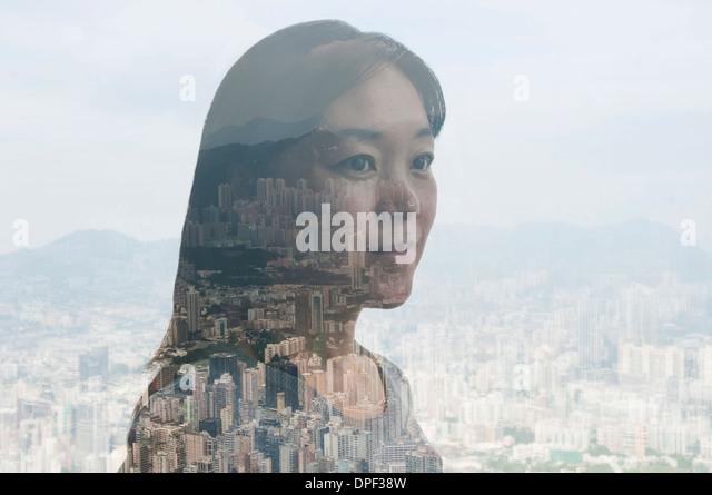 Geschäftsfrau und Hong Kong Stadtbild, zusammengesetztes Bild Stockbild