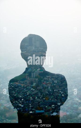 Geschäftsmann und Hong Kong Stadtbild, zusammengesetztes Bild Stockbild
