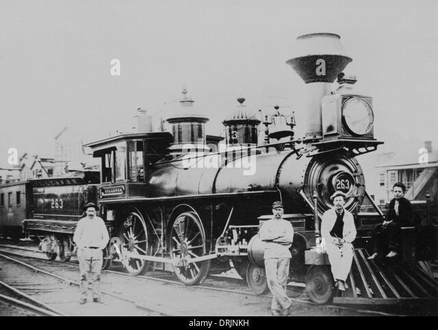 Eine alte altmodische Dampfzug und Arbeitnehmer Stockbild
