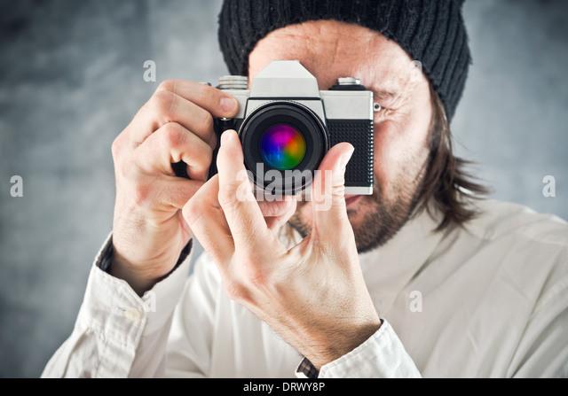 Kaufmann unter Bild mit alten Vintage Film-Foto-Kamera Stockbild