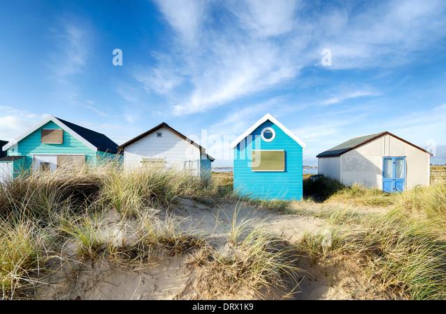 Strandhütten auf Mudeford Landzunge in der Nähe von Christchurch in Dorset Stockbild