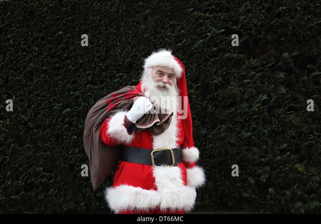 Weihnachtsmann mit Sack über die Schulter Stockbild