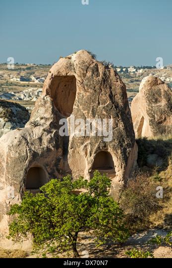 Wohnungen in Fee Schornsteine, Red Valley, Kappadokien, Türkei Stockbild