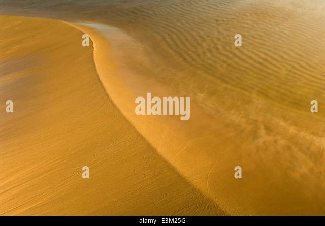 Sand, Wasser und Zeit am Lake Superior, Michigan, USA Stockbild