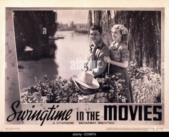 SWINGTIME IN THE MOVIES, USA Lobbycard, von links: John Carroll, Kathryn Kane, 1938 Stockbild