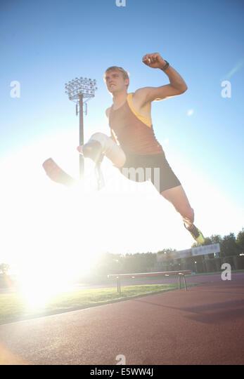 Sprinter Mitte springen Stockbild