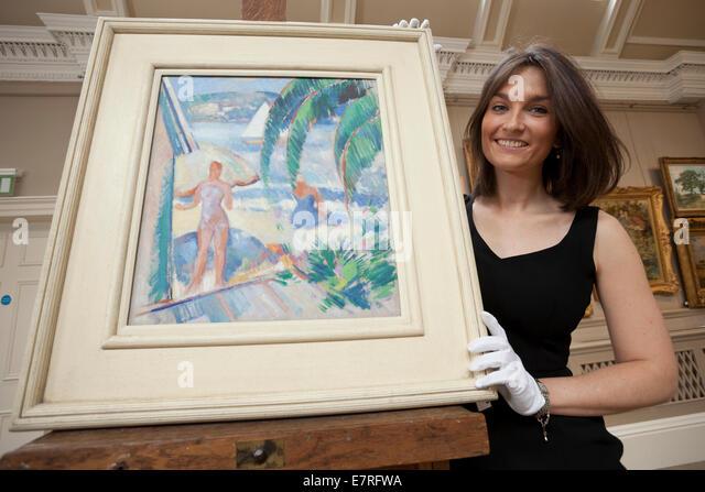 Edinburgh, Schottland. 22. September 2014. Saskia Robertson, der Bonhams, bereitet Gemälde für den Verkauf - Stock-Bilder