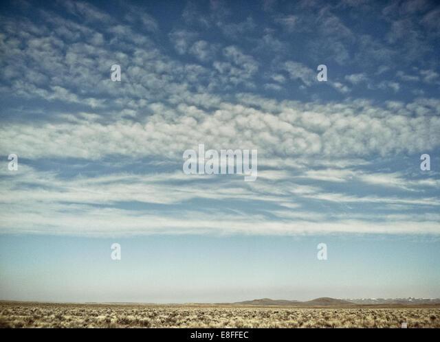 Wolken über der Wüste Stockbild