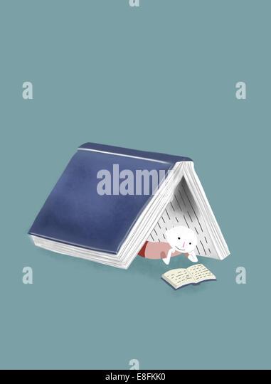 Abbildung eines Knaben, ein Buch zu lesen Stockbild