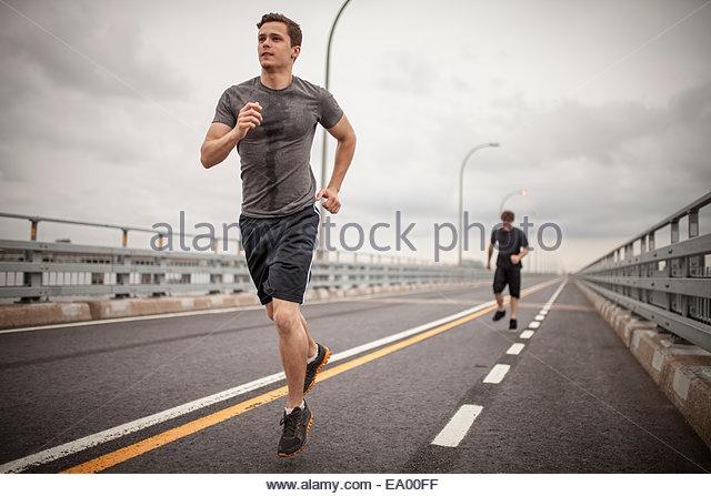 Junge Männer, Joggen Stockbild