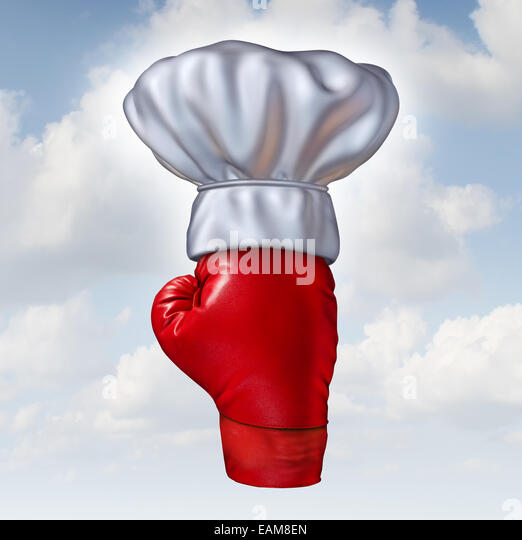Essen Wettbewerb Konzept und Top Meisterkoch Symbol als eine rote Boxhandschuh mit einer weißen Küche Stockbild