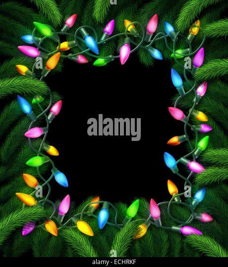 Weihnachtslicht Rahmen und Silvester Weihnachtsdekoration auf einem schwarzen Hintergrund mit Tannenzweigen dekorierten Stockbild