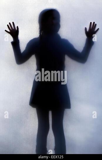 Silhouette eines Mädchens Stockbild