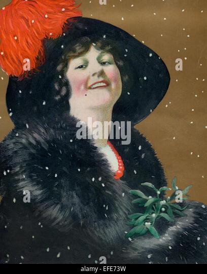 Weihnachten 1911 eine Illustration zeigt Schnee, der auf einer schönen Frau einen großen Hut mit Mistel. Stockbild