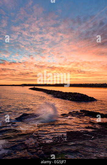 Sonnenuntergang am Newbiggin by the Sea Stockbild