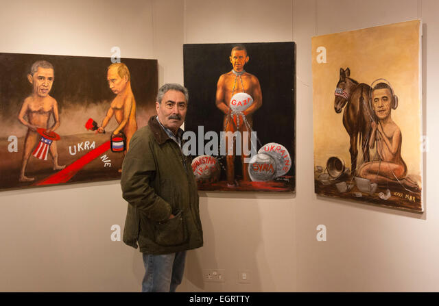 London, UK. 1. März 2015. Kaya Mar mit Gemälden, Barack Obama und Vladimir Putin. Die Ausstellung Farbe Stockbild