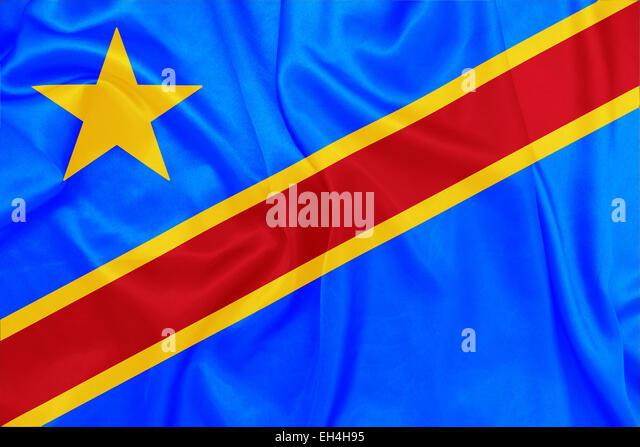 Demokratische Republik Kongo - wehende Nationalflagge auf Seide Textur Stockbild