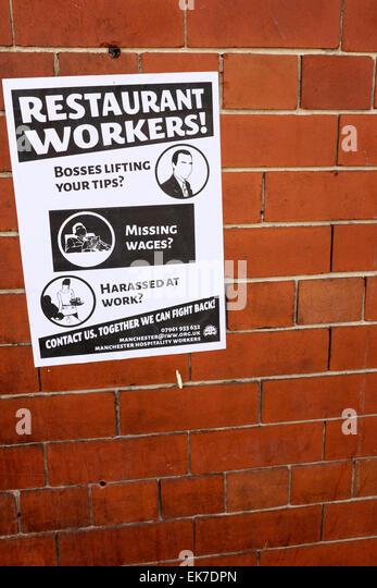ein Hinweis auf eine Wand richtet sich an Restaurant Arbeiter, die ausgebeutet werden können Stockbild