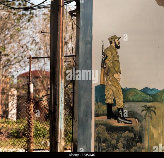 Teil eines Wandbildes auf einer Wand mit einem Foto von der kubanische Revolutionsführer Fidel Castro bei Camilo Stockbild