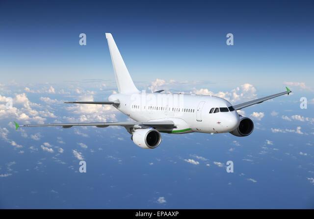 Flugzeug Auf Reisen ??ber Den Wolken Stockbild